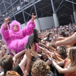 Crowdsurfing Pink Monkey by Scott Dudelson